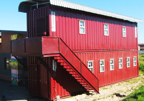Shipping containers converted into housing, stacked on top of one another