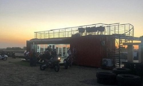 Motorbikers enjoying their evening with their modified shipping container