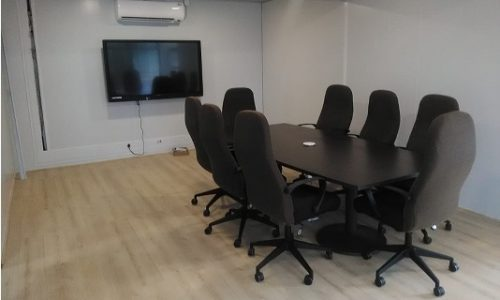 Boardroom with wooden flooring in container conversion