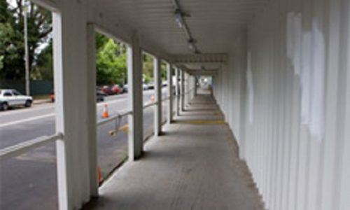 Shipping containers converted for safe construction walkway (tunnel)