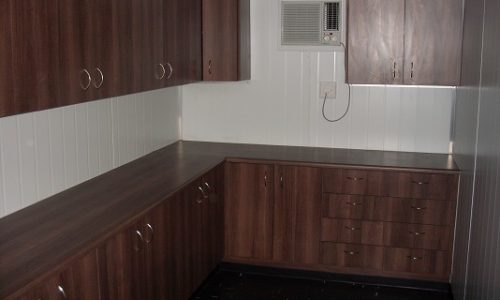 Executive Office with counter and wooden cupboards