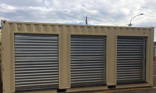 Shipping container storage units with roller doors